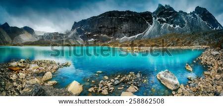 Beautiful mountain view with reflection in Gokyo Lake, Himalayas, Nepal. - stock photo