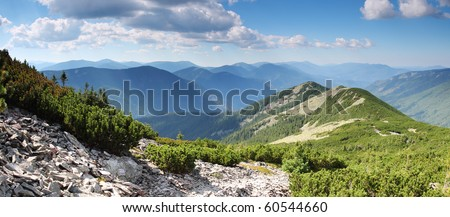 Beautiful mountains landscape and blue sky - stock photo