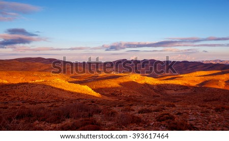 Beautiful mountains landscape, golden dry grass on the hills, amazing view on Lebanese countryside in sunny day  - stock photo