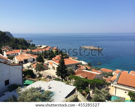 Beautiful mountains of Montenegro, azure Adriatic sea, rooftops