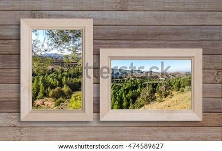 Beautiful mountains view landscape posters in frames, on wooden panels background