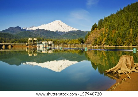 Beautiful Mt Baker reflection over Baker Lake and The Baker lake dam - stock photo