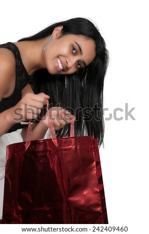 Beautiful multi ethnic diverse woman on a shopping spree - stock photo
