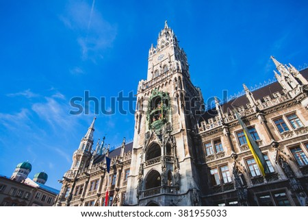 Beautiful multicolored downtown picture of street in Munich, Bayern, Bavaria, Germany, leading to Marienplatz, with tourists and people walking near shop-windows and restaurants, sunny summer day