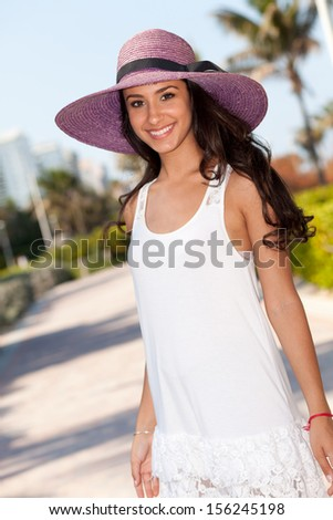 Beautiful multicultural young woman enjoying Miami Beach. - stock photo