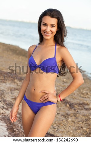 Beautiful multicultural young woman outdoor beach portrait. - stock photo
