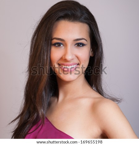 Beautiful multicultural young woman studio portrait.