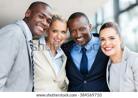 beautiful multiracial businesspeople looking at the camera - stock photo