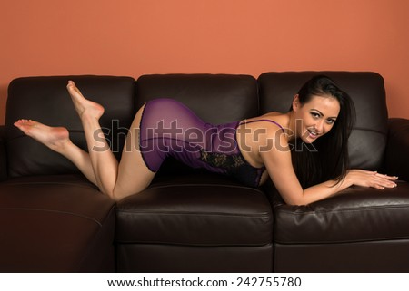 Beautiful multiracial woman in a purple camisole