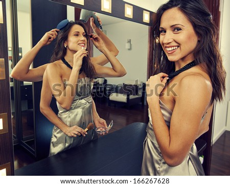beautiful multitasking woman ready for party