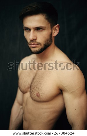 Beautiful muscular male model with nice abs - stock photo