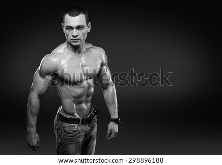 Beautiful muscular male model with nice abs in jeans with copy space. Clipping path included.