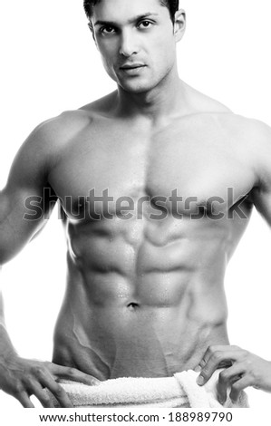 Beautiful muscular man with the towel in black and white