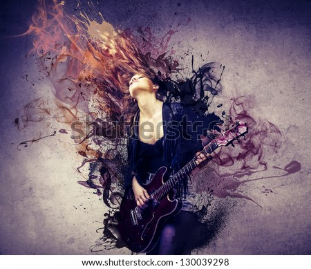 beautiful musician playing guitar - stock photo