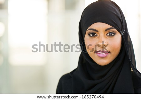 beautiful muslim businesswoman in modern office - stock photo