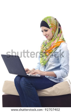 Beautiful muslim woman smiling chat with her friends using computer - stock photo