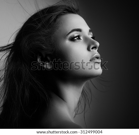 Beautiful mystic woman profile with long hair looking. Black and white portrait. CLoseup - stock photo