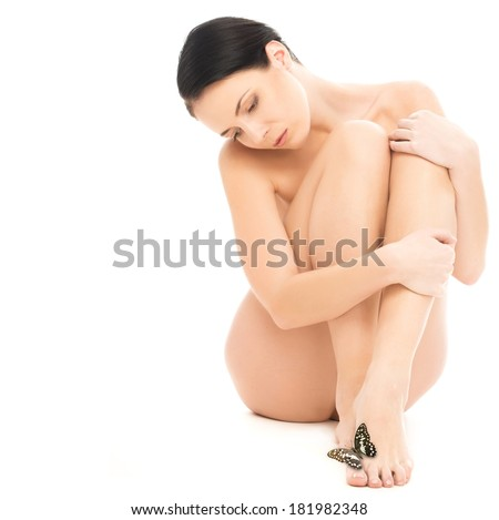 Beautiful naked brunette woman with butterfly on her leg isolated on white background  - stock photo