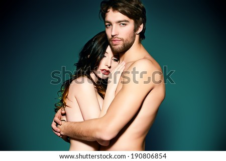 Beautiful naked couple in love in a tender embrace. - stock photo