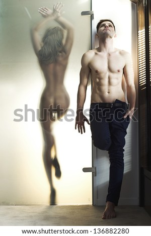 Beautiful naked woman and handsome man - stock photo