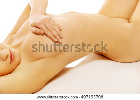 Beautiful naked woman covering her breast - stock photo