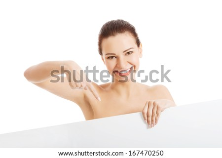 Beautiful naked woman holding copy space. isolated on white. - stock photo