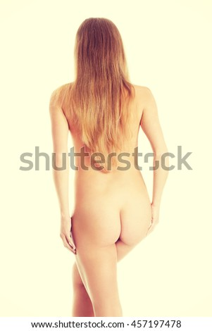 Beautiful naked woman's back with supple buttocks.