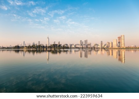 beautiful nanjing skyline are reflected in the lake - stock photo