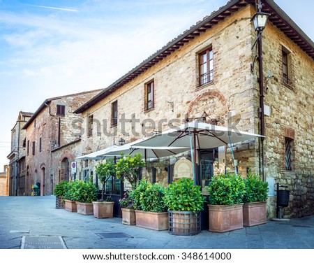 Beautiful narrow street of old Montepulciano town in Tuscany - stock photo