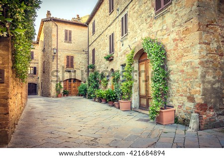 Beautiful narrow street of old Pienza town in Tuscany - stock photo