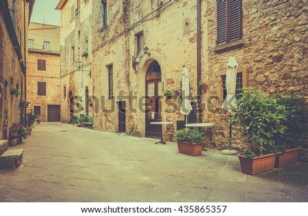 Beautiful narrow street of old Pienza town in Tuscany