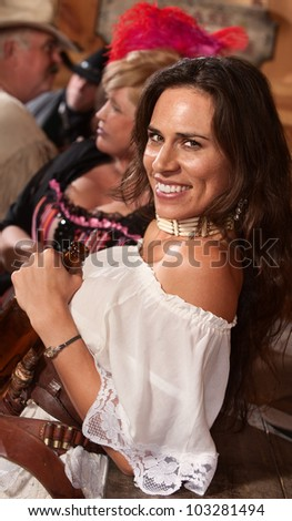 Beautiful Native American gunfighter with bottle in old west saloon - stock photo