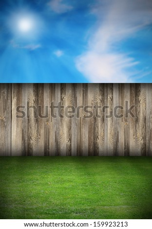 beautiful natural backdrop with wooden fence and green turf