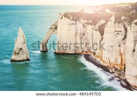 Beautiful natural cliff in Etretat, Normandy, France during a sunny summer day.