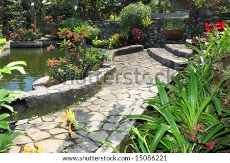 Beautiful natural garden with pond - stock photo