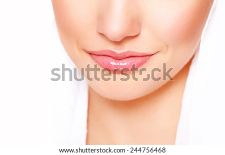 Beautiful natural lips with nude makeup - stock photo