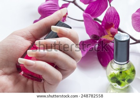 Beautiful natural long nails on white background