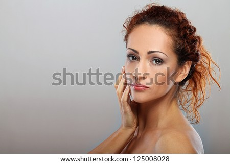 Beautiful natural middle aged woman  isolated on grey background - stock photo