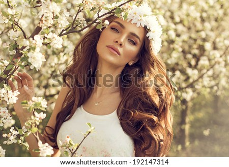 Beautiful natural woman in the garden of apple - stock photo