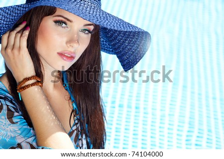 Beautiful natural woman smiling in pool on summer vacations. - stock photo