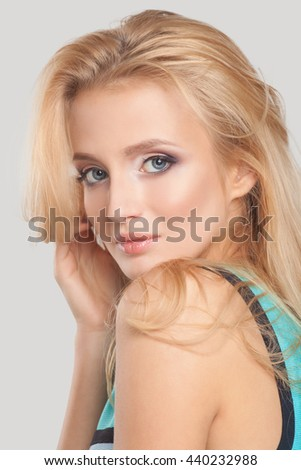 Beautiful natural woman with fashion make-up and blonde hair, portrait of an young girl isolated on white