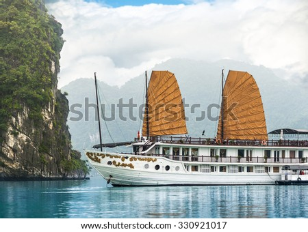 Beautiful nature in Halong bay, Vietnam, Asia. Picturesque scene with blue sky, ripple on water and mountains. Houseboat. Idea of recreational tourism. Tranquil view of seascape.