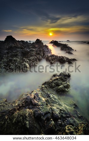 Beautiful nature landscape of Chendering Beach, Pandak , located in Terengganu, Malaysia with unique formation rocks, (  Sunrise seascape ,Soft focus due to long exposure shot. Nature composition )