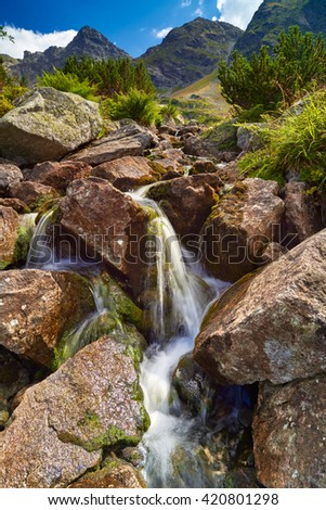 Beautiful nature landscape rocks stones water Gasienica Valley High Tatra Mountains Carpathians Poland spring summer brook - stock photo