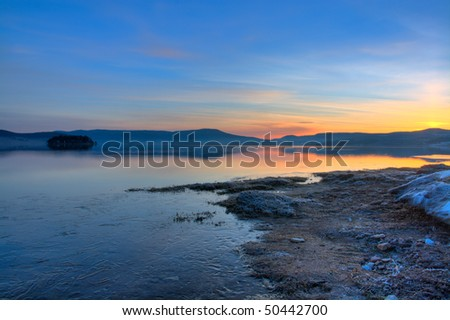 beautiful nature landscape; sunrise on the bulgarian Batak dam lake - stock photo