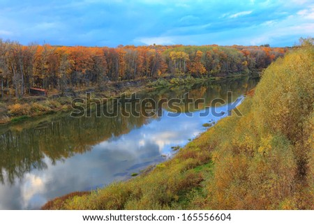 beautiful nature landscape yellow autumn fall river flows and blue sky