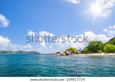 Beautiful nature on the shore of the turquoise waters of the ocean. Tropical greenery. The Seychelles. - stock photo