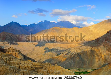 Beautiful nature scenery with rugged multicolored rocks against the background of bright blue sky in Himalaya mountains (view from Lamayuru Monastery), Ladakh range, Jammu & Kashmir, Northern India - stock photo