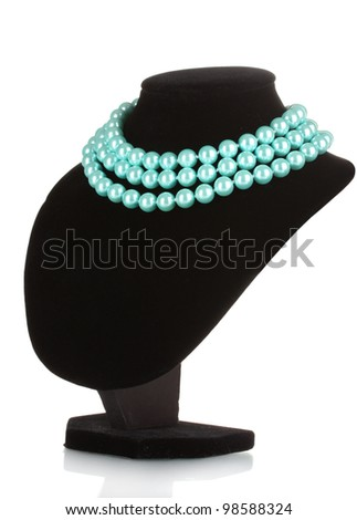 beautiful necklace of blue pearls on a mannequin isolated on white - stock photo
