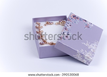 Beautiful necklace with earrings in a purple gift box.